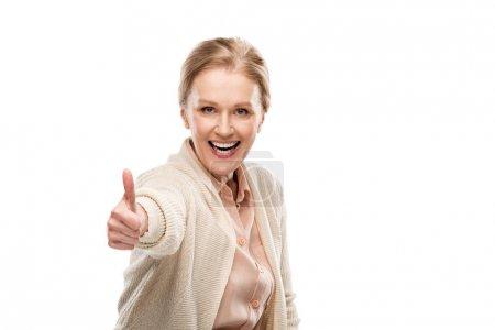 Photo pour Excité femme d'âge moyen montrant pouce vers le haut signe isolé sur blanc - image libre de droit
