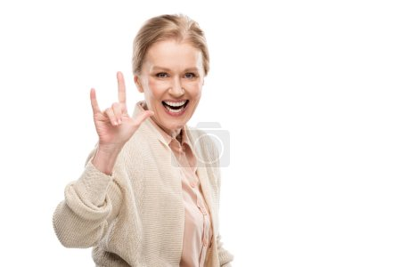 Photo for Excited middle aged woman showing rock sign Isolated On White - Royalty Free Image
