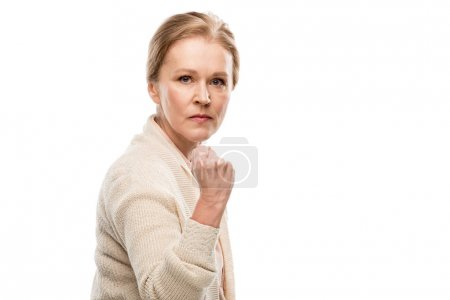 Photo for Angry middle aged woman with clenched fist Isolated On White - Royalty Free Image