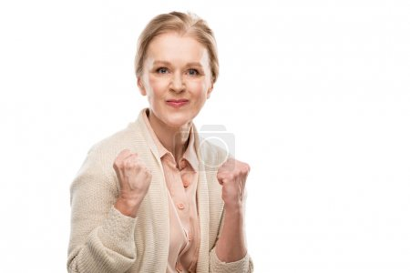 Foto de Dissatisfied middle aged woman with clenched fists Isolated On White - Imagen libre de derechos