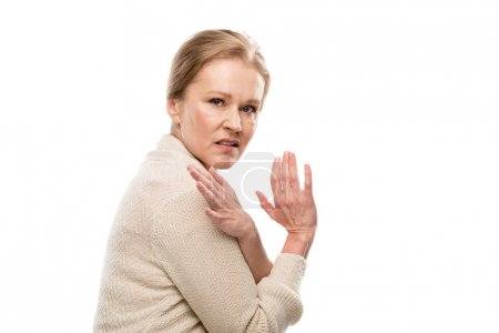 Photo for Scared middle aged woman looking at camera and Gesturing with hands Isolated On White - Royalty Free Image