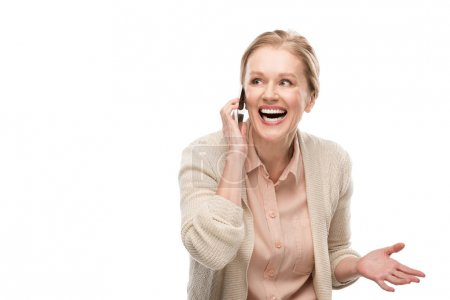 Photo for Happy middle aged woman talking on smartphone and Gesturing Isolated On White - Royalty Free Image