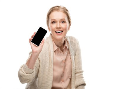 Photo for Excited middle aged woman showing smartphone with blank screen Isolated On White - Royalty Free Image