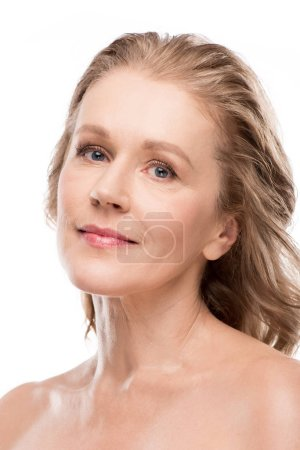 Foto de Beautiful middle aged woman with clean face looking at camera Isolated On White - Imagen libre de derechos
