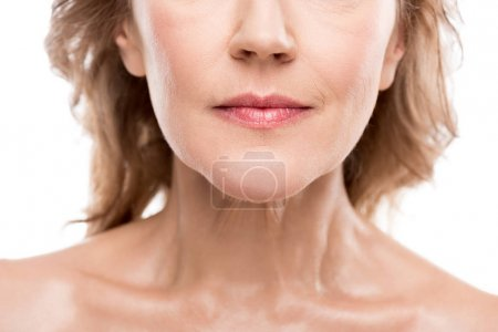 Foto de Cropped view of middle aged woman with clean face Isolated On White - Imagen libre de derechos