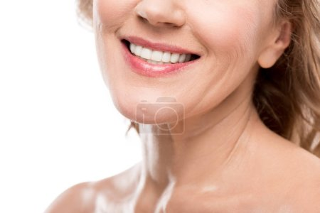 Foto de Cropped view of smiling middle aged woman with clean face Isolated On White - Imagen libre de derechos