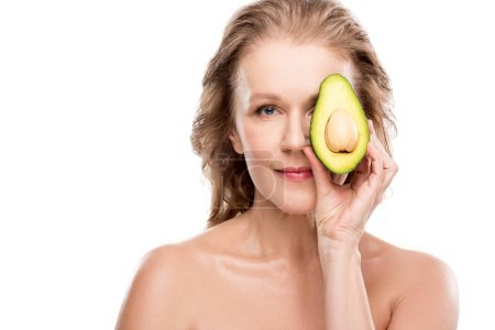 Photo for Attractive nude middle aged woman posing with avocado Isolated On White - Royalty Free Image