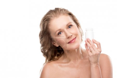 nude mature woman with bottle of medicine Isolated On White