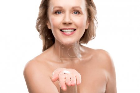 Photo for Nude mature woman holding pills Isolated On White - Royalty Free Image