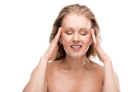 Photo pour Belle femme mûre avec le mal de tête touchant le visage isolated On White - image libre de droit