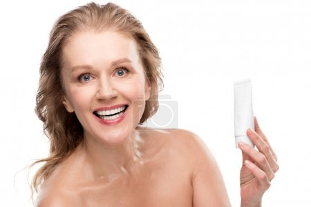 Photo for Attractive mature woman with perfect skin holding moisturizing Face cream Isolated On White - Royalty Free Image