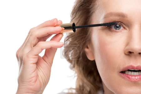 Photo for Cropped view of mature woman applying mascara Isolated On White - Royalty Free Image