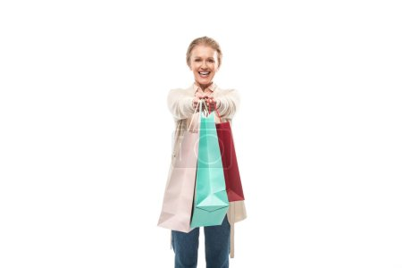 Photo for Smiling middle aged woman with shopping bags Isolated On White with copy space - Royalty Free Image