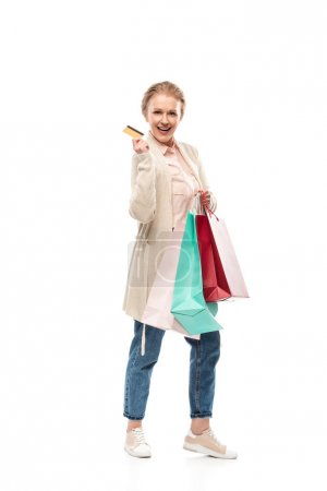 Photo for Happy middle aged woman with shopping bags and Credit card On White - Royalty Free Image