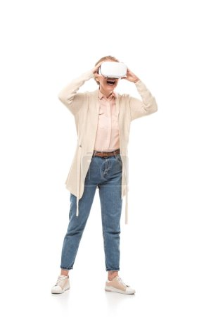 Photo for Excited woman in vr headset experiencing Virtual reality Isolated On White - Royalty Free Image
