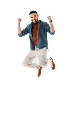 Photo for Happy man jumping and showing winner gesture isolated on white - Royalty Free Image