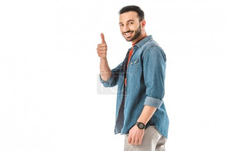 cheerful man showing thumb up and looking at camera isolated on white