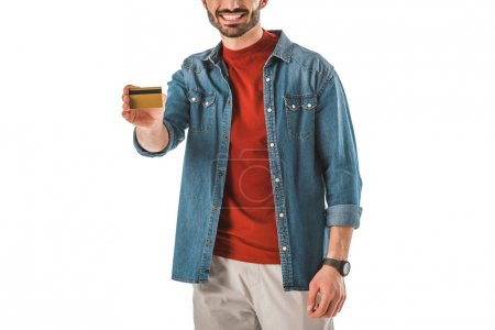 Photo for Partial view of man in denim shirt holding credit card isolated on white - Royalty Free Image