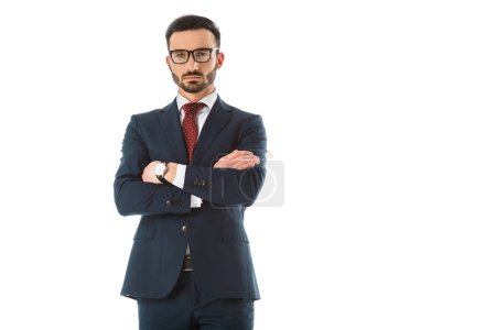 Photo for Serious businessman standing with crossed arms and looking at camera isolated on white - Royalty Free Image