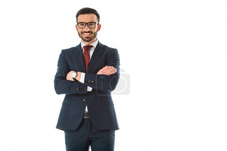 Photo for Smiling businessman standing with crossed arms and looking at camera isolated on white - Royalty Free Image