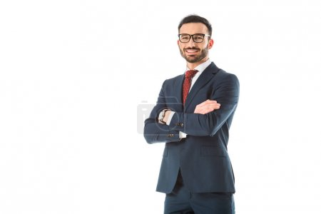Photo for Happy businessman standing with crossed arms and looking at camera isolated on white - Royalty Free Image