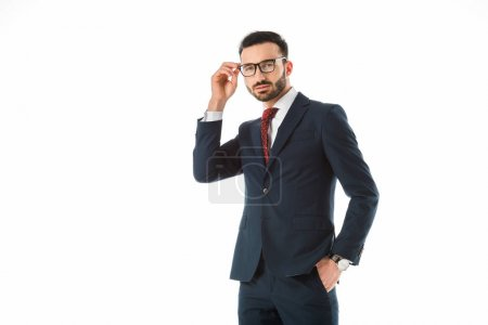 Photo for Confident businessman touching glasses and looking at camera isolated on white - Royalty Free Image