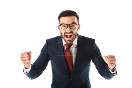 Photo for Irritated businessman screaming and showing fists while looking at camera isolated on white - Royalty Free Image