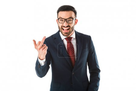 Foto de Irritated businessman quarreling and showing middle finger while looking at camera isolated on white - Imagen libre de derechos