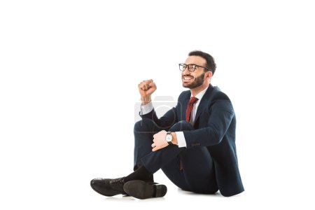 Photo for Cheerful businessman showing yes gesture while sitting on white background - Royalty Free Image