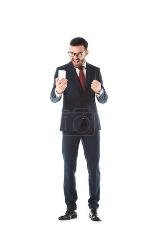 Photo for Irritated businessman screaming and showing fist while having video call on smartphone isolated on white - Royalty Free Image