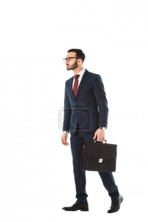 serious businessman with briefcase looking away isolated on white