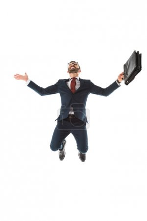 excited businessman with briefcase smiling and jumping isolated on white