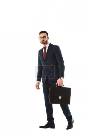 Photo for Confident businessman with briefcase looking at camera isolated on white - Royalty Free Image