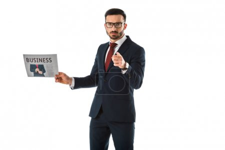 Photo for Serious businessman holding businessman holding newspaper and pointing with finger at camera isolated on white - Royalty Free Image