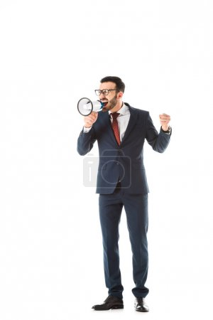 Photo for Angry businessman screaming in megaphone and showing fist isolated on white - Royalty Free Image