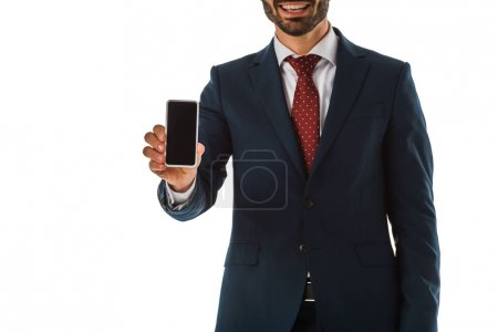 Foto de Partial view of businessman in black suit holding smartphone with blank screen isolated on white - Imagen libre de derechos