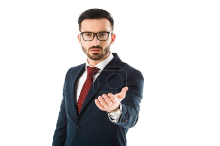 Photo for Handsome bearded businessman looking at camera with outstretched hand isolated on white - Royalty Free Image