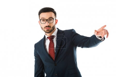Photo for Serious businessman in glasses pointing with finger and looking at camera isolated on white - Royalty Free Image