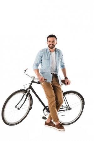 Photo for Handsome bearded man with bicycle smiling and looking at camera isolated on white - Royalty Free Image