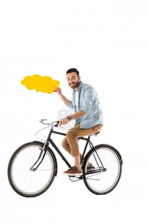 Photo for Cheerful man riding bicycle while holding thought bubble isolated on white - Royalty Free Image