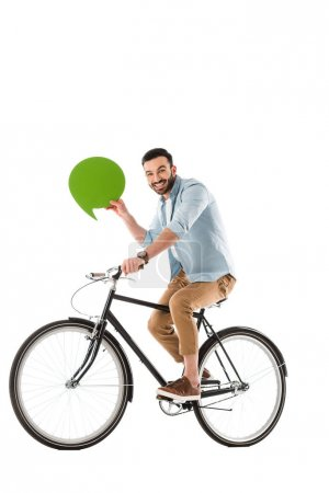 Photo for Cheerful bearded man riding bicycle while holding thought bubble isolated on white - Royalty Free Image