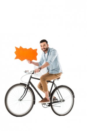 Photo for Happy handsome man riding bicycle while holding thought bubble isolated on white - Royalty Free Image