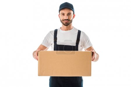 Photo for Cheerful handsome delivery man holding cardboard box and smiling at camera isolated on white - Royalty Free Image