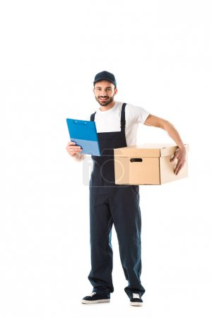 Photo for Cheerful delivery man with carton box holding clipboard and smiling at camera isolated on white - Royalty Free Image