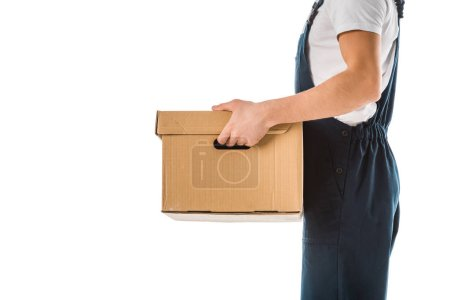 Photo for Cropped view of delivery man in overalls holding cardboard box isolated on white - Royalty Free Image