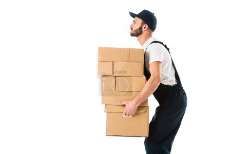Photo for Side view of serious delivery man carrying cardboard boxes isolated on white - Royalty Free Image