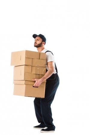 Photo pour Beau livreur sérieux portant des boîtes en carton isolé sur blanc - image libre de droit