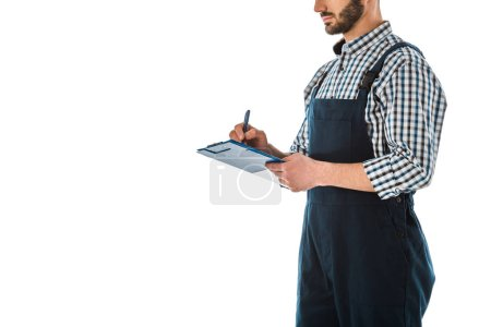 Photo for Partial view of construction worker writing on clipboard isolated on white - Royalty Free Image
