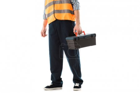 Photo pour Vue recadrée de travailleur de construction dans la boîte à outils de fixation de gilet de sécurité d'isolement sur le blanc - image libre de droit