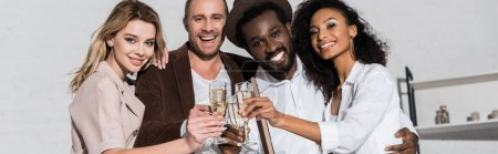 Photo for Panoramic shot of happy multicultural friends holding champagne glasses - Royalty Free Image